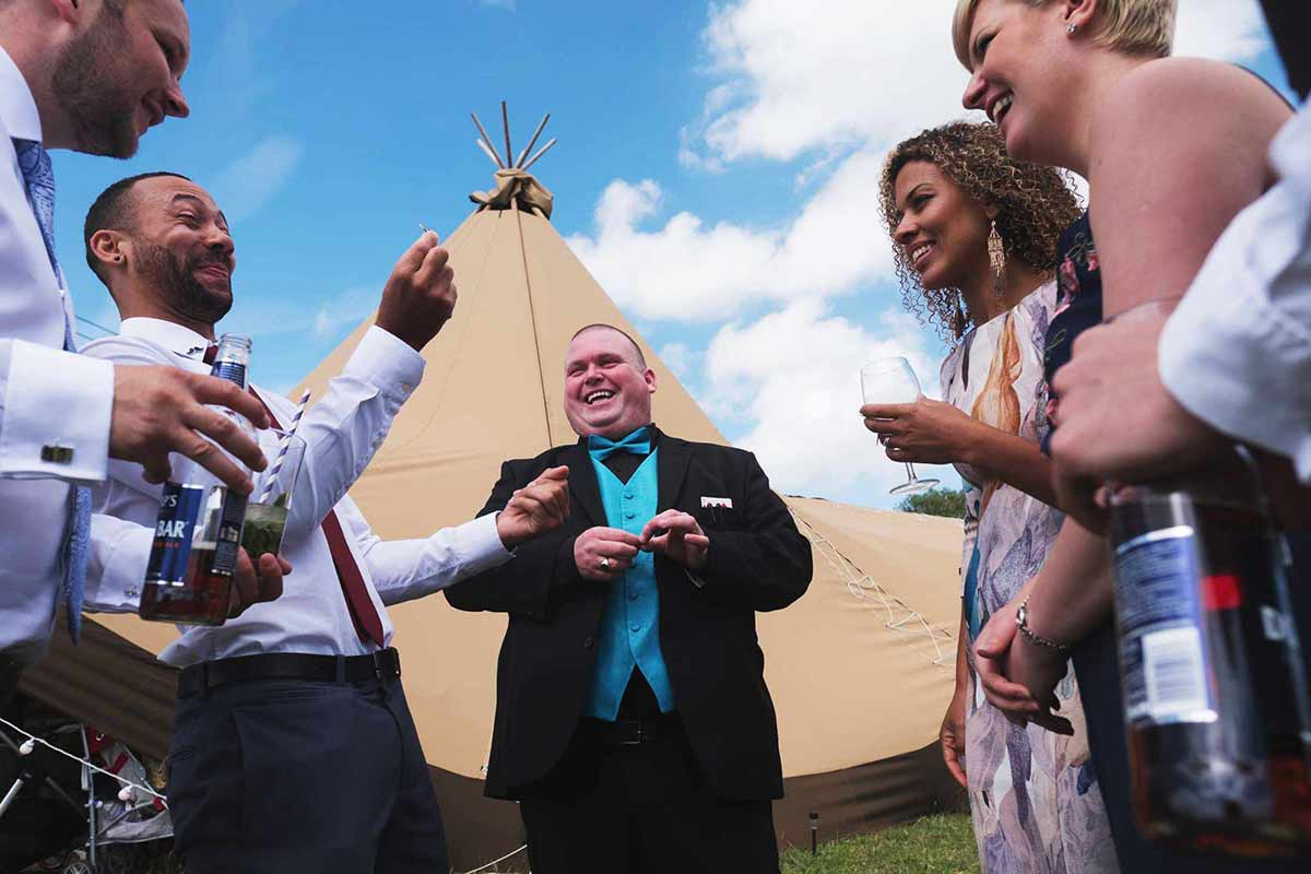 Derby wedding magician Paul Grundle performing close up magic to guests at a wedding